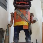 giant wooden toy soldier with long nose