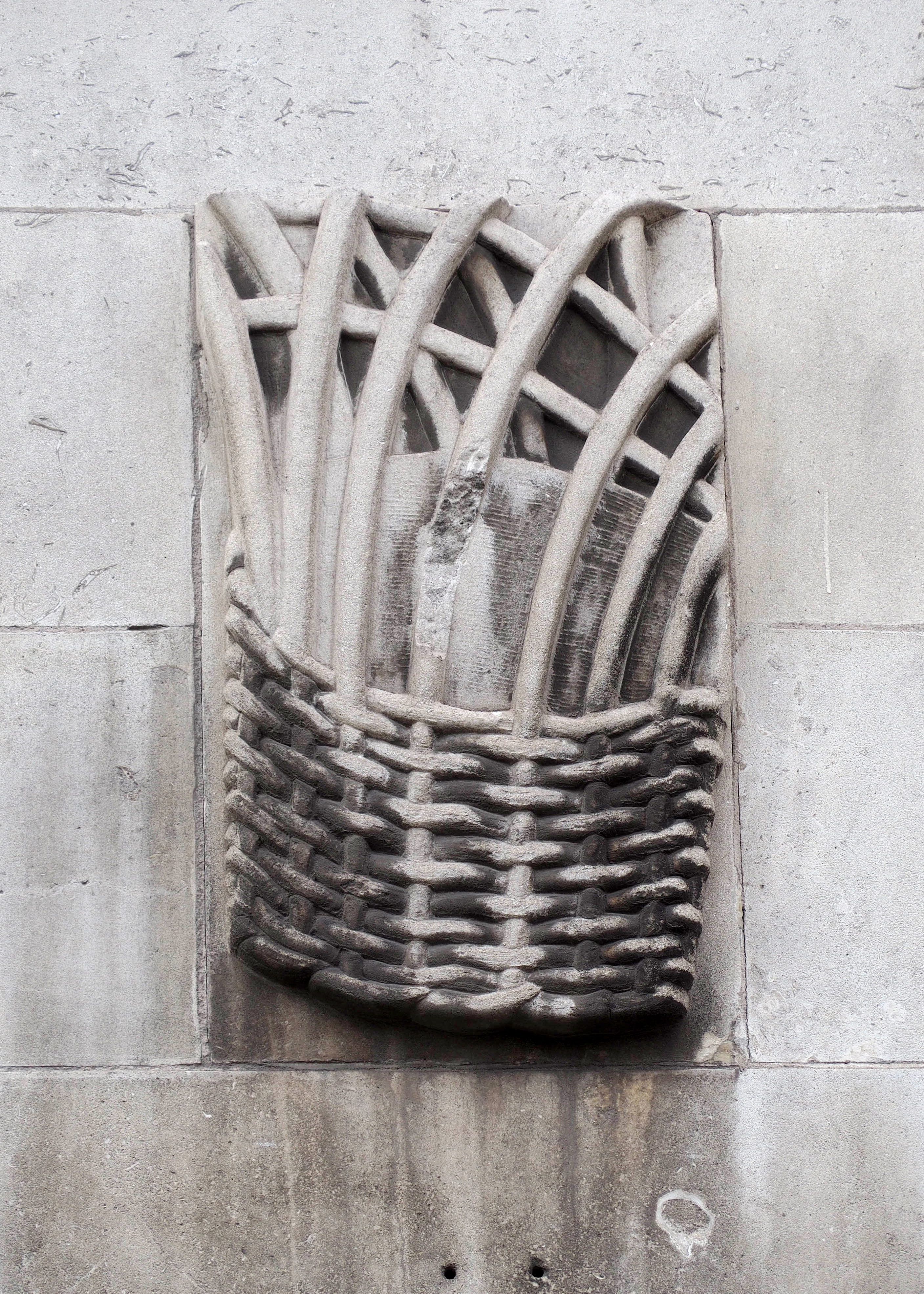 Relief from the Royal School for the Blind in Liverpool showing a woven basket.