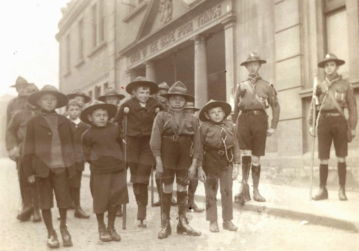 image of young disabled boys outside the School of the Brave Poor things in scout uniform