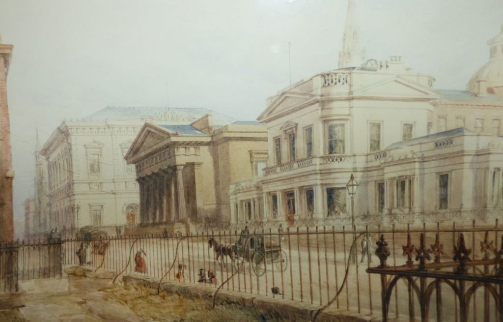 Painting shows the Hardman Street site including the chapel with Doric columns and a carriage passing along the street in front of the building.