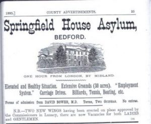 A cutting from Kelly's Directory of Bedfordshire, 1885, showing a line print of Springfield House Asylum, Bedford, and advertising its facilities and vacancies.