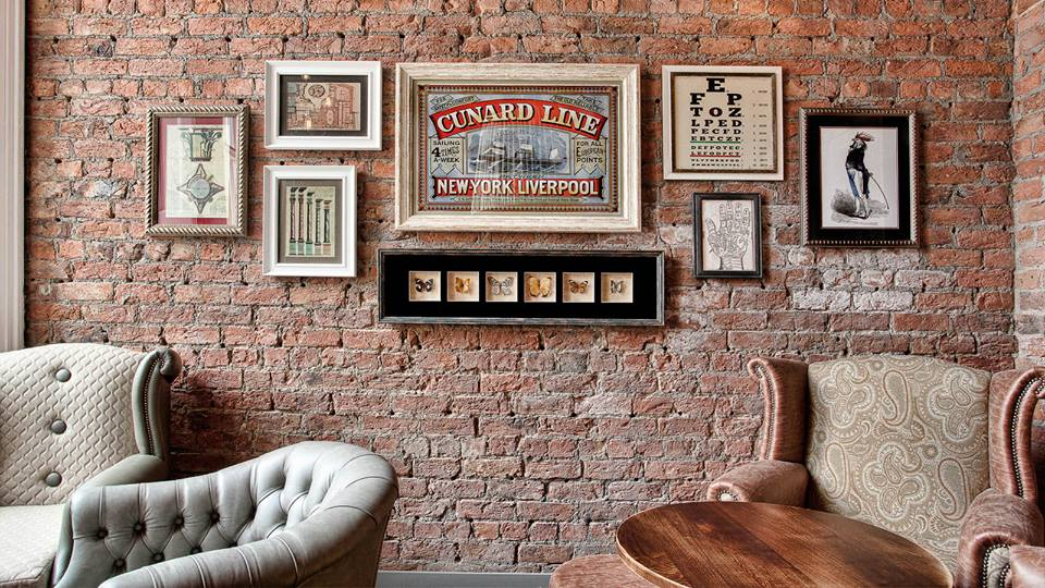 Exposed brick wall with memorabilia from the Old Blind School