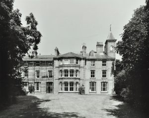 Exterior of imposing Victorian building at Langdon Down with lawn and trees