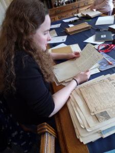 One of our researchers, Anna, is sat at the table looking through a box of letters