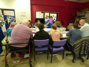 Members of Mencap Liverpool are sat around a table