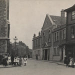 Bristol street - no sign of traffic, but many young children standing about on the pavements.