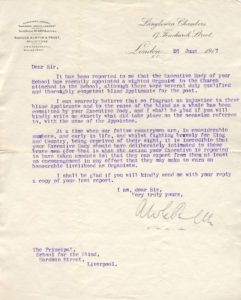 Image shows headed notepaper with a curving script, typed on in purple ink