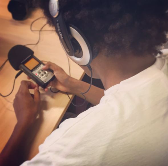 A young person uses a handheld microphone