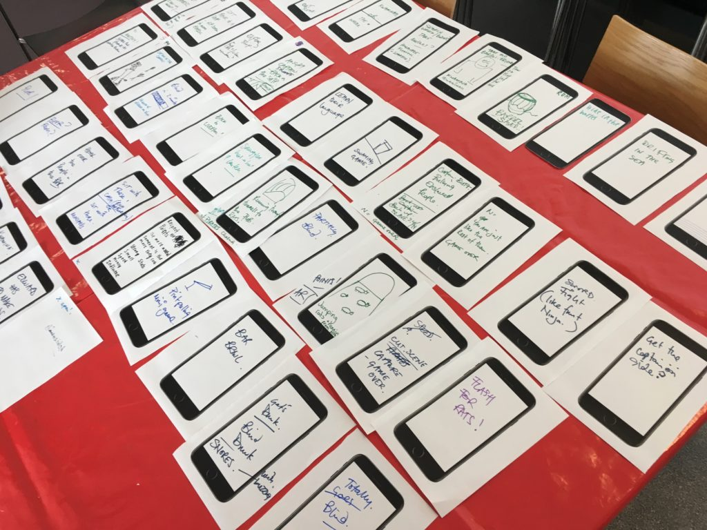 We sketched our ideas for each scene of the game onto pictures of a mobile phone screen-the image shows all f the A5 pieces of paper lined up in order of when the scene occurs in the game