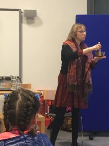 Liz Porter, a partially sighted storyteller who is interested in the representation of disability within traditional stories, stands to tell a story using a musical bowl