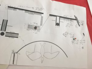 The image shows a floor plan of a museum space and the young person has sketched over and written in ideas for an accessible disosaur exhibition.