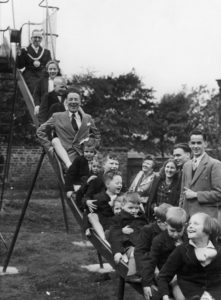 man and several children on a slide