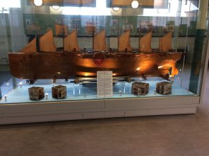 Wooden model boat with many sails