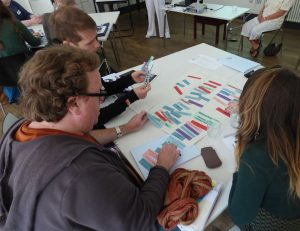 Liverpool volunteers glue words to paper as they consider language and disability