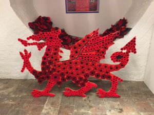Image shows red Welsh dragon made out of poppies.=