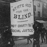 Image depicting marchers with banner that reads 'State aid for the blind. Not charity but social justice'