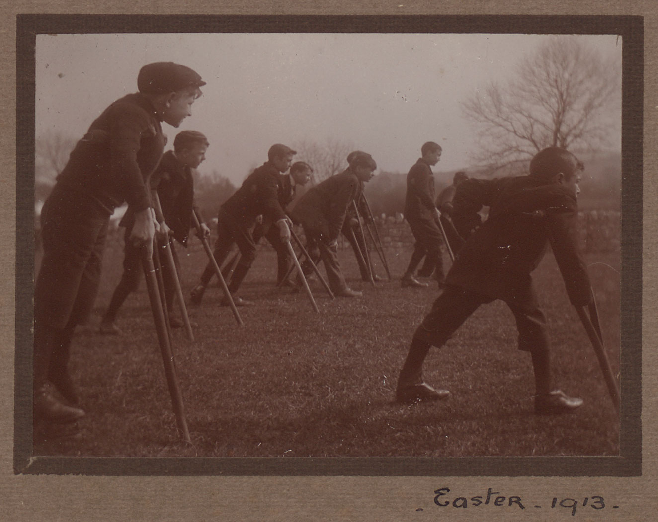 Boys with crutches stand in a line, perhaps at the start of a race
