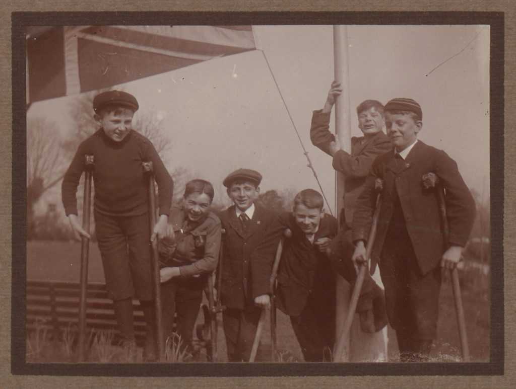 Boys with crutches at the Guild's holiday home