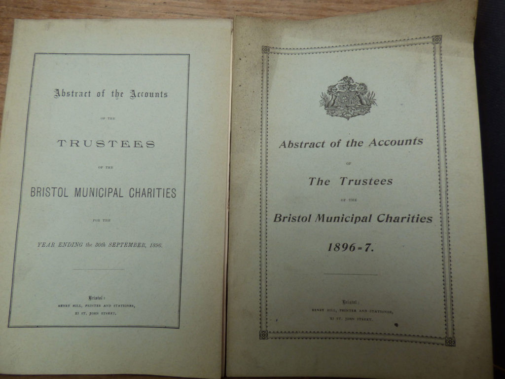 Image shows book of accounts with yellowing pages