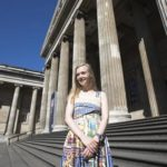 Jessica stands in front of the British Museum on a sunny day