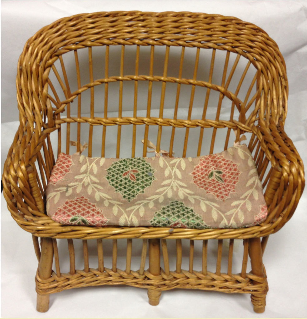 wicker sofa with patterned cushion