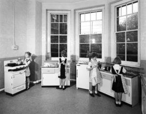 four girls in a kitchen