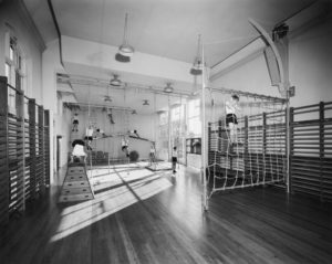 Gym at the School with children climbing ropes